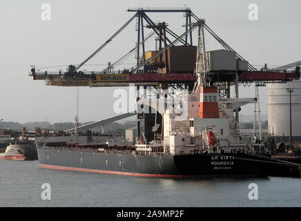 AJAXNETPHOTO. 23RD SEPTEMBER, 2019. DUNKERQUE, FRANCE. - LOADING COAL - THE MONROVIAN REGISTERED BULK CARRIER AM KIRTI (93,000GT) AT THE PORT'S SEA BULK DUNKERQUE COALING FACILITY.PHOTO:JONATHAN EASTLAND/AJAX REF:GX8_192609_20537 - Stock Photo