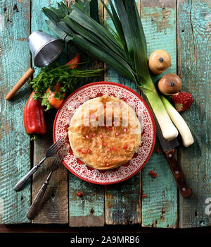 Healthy food. Homemade phyllo pastry pie with raw peppers, leek and pomegranate seeds on wooden background top view copy space overhead view - Stock Photo