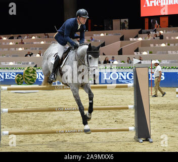 LOS ANGELES, CA. October 01, 2015: Raymond Texel (USA) riding Coupis in the Artemide Trophy International jumping competition at the 2015 Longins Masters Los Angeles at the L.A. Convention Centre. © 2015: Paul Smith / Featureflash - Stock Photo