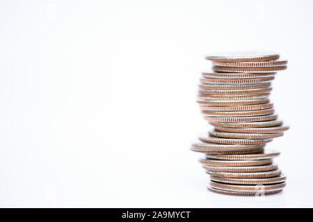 coins stacked on white background quarters and change - Stock Photo