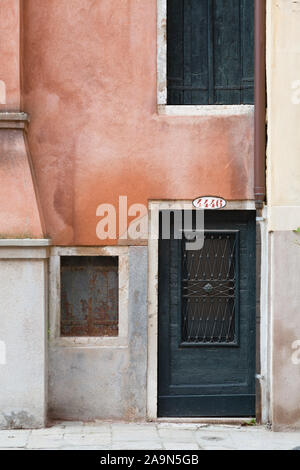 VENICE, ITALY - December 24, 2012. Address number above the front door to a small house in Venice, Italy - Stock Photo