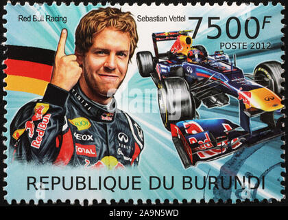 Racing driver Juan Sebastian Vettel on postage stamp - Stock Photo