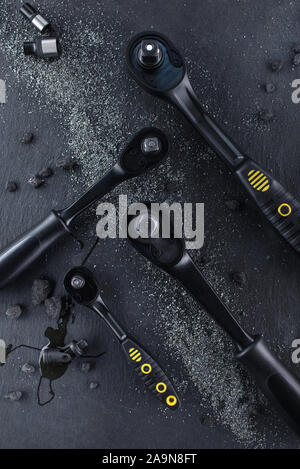 Professional ratchet tools placed on a black background, Wrench Tool for the work in the workshop. - Stock Photo