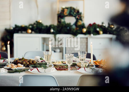 Background image of beautiful table setting for Christmas party with fir elegant candles and delicious homemade food, copy space - Stock Photo