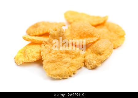 Cornflakes isolated macro. Small pile of corn flakes on white background - Stock Photo