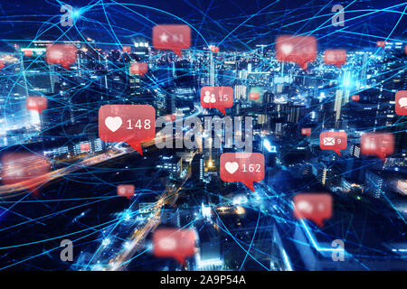 Fast internet connection in the city at night. Concept of social network, technology and innovation - Stock Photo