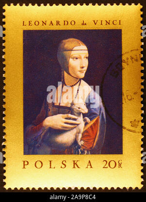 Painting Lady with an ermine by Leonardo on postage stamp - Stock Photo