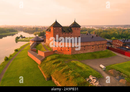 Ancient fortress against the backdrop of the cityscape on a dawn (shooting from a quadrocopter). Hameenlinna, Finland - Stock Photo