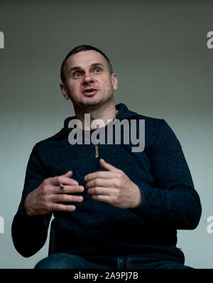 London, UK. 16th November, 2019. Oleg Sentsov speaks and signs copies of his book 'The Marketeer' at the Ukrainian Cultural Centre. Sentsov is a Ukrainian filmmaker, writer and activist from Crimea. Following the Russian annexation of Crimea in 2014 he was arrested in Crimea and sentenced to 20 years' imprisonment by a Russian court on charges of plotting terrorism acts. The conviction was described as fabricated by Amnesty International and others. He was awarded the European Parliament's Sakharov Prize in 2018. He was released in a prisoner swap. Credit: Guy Corbishley/Alamy Live News - Stock Photo