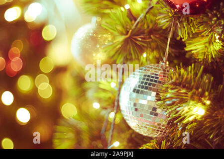 Decorated Christmas tree on blurred varicolored new year's background  . Christmas Ornament On Wooden Background With Snowflakes, Greeting card Merry - Stock Photo