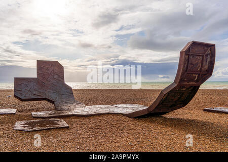 Brighton and Hove, East Sussex, UK - November 4, 2019: Passacaglia sculpture by Charles Hadcock on the beach in Brighton, UK. Passacaglia is a huge, c