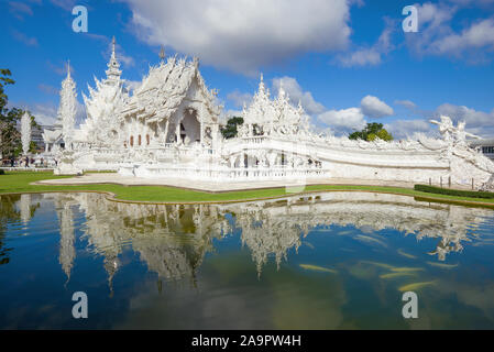 CHIANG RAY, THAILAND - DECEMBER 16, 2018: View of the futuristic Buddhist temple Wat Rong Khun (White Temple) on a sunny day - Stock Photo