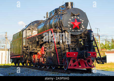SHARYA, RUSSIA - JUNE 27, 2019: Soviet steam locomotive of the L series - a monument at the Sharya railway station - Stock Photo