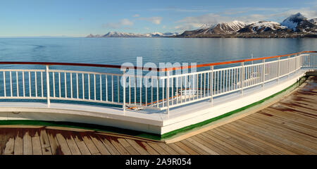 The coastline of Spitsbergen, seen from a cruise ship sailing into Kongsfjorden. - Stock Photo