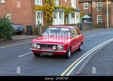 Rye, East Sussex, UK. 17th Nov, 2019. The annual classic car rally arrives in the ancient town of Rye in East Sussex parading classic and custom build cars from the 40's, 50's and later to the waiting public lining the high street. Drivers and passengers dress up appropriately for the event which will start at 2.30pm. Ford 1969 Lotus Cortina MK2. ©Paul Lawrenson 2019, Photo Credit: Paul Lawrenson / Alamy Live News - Stock Photo