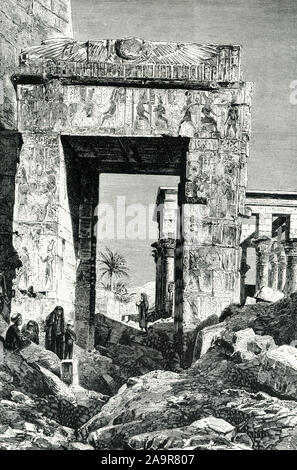 Shown here is the Temple of Isis at Philae. The image dates to around 1905. The island of Philae was located in theNile Riverat the First Cataract, south of the present Aswan dam; it is now totally submerged, following the construction of the Aswan dam.This temple, thought to be the single most beautiful preserved ancient Egyptian temple, housed amammisi,or birth house, built to celebrate the birth of Harpocrates to Isis and Osiris. The Isis temple is of Ptolemaic date (304 b.c.e.–30 b.c.e.), specifcally about 280 B.C. - Stock Photo