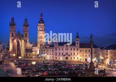 Hradec Kralove, Czechia. View of Market square with Cathedral of the Holy Spirit and White Tower at dusk - Stock Photo