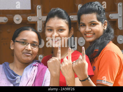 First time voters shows her inked finger outside a polling station during the Civic Body Polls in Beawar, Rajasthan, India. Photo/Sumit Saraswat - Stock Photo