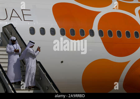 Dubai, United Arab Emirates. 17th Nov, 2019. Visitors wearing a national arabic outfits are seen during the opening day of Dubai International Airshow. Credit: Leonid Faerberg/SOPA Images/ZUMA Wire/Alamy Live News - Stock Photo