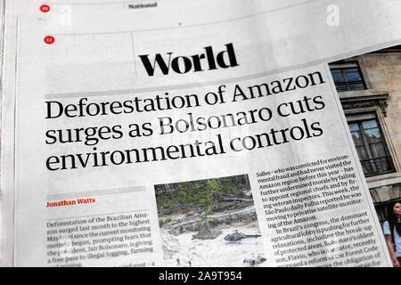 'Deforestation of Amazon surges as Bolsonaro cuts environmental controls' Guardian newspaper headline article on 4 June 2019 in London UK - Stock Photo