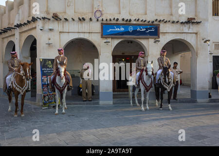 Doha-Qatar,January 24,2013: Old police station in Souk Waqif Doha Qatar daylight view with traditional guards riding horses in front of it - Stock Photo