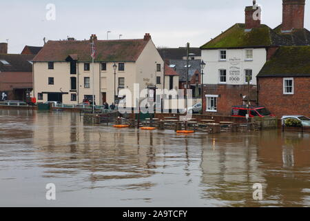 As the rains keep falling the barriers at Upton guarding the village from the Severn flood waters stand their ground despite the increasing waters. - Stock Photo