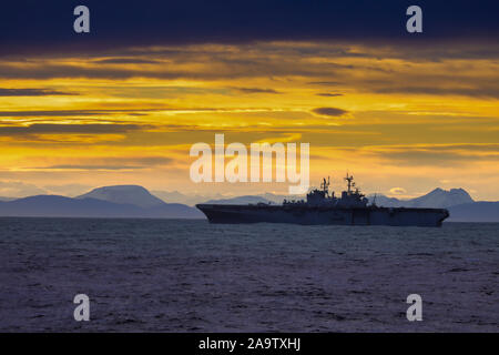 USS Iwo Jima a Wasp class amphibious assault ship of the United States Navy off the coast of Norway - Stock Photo