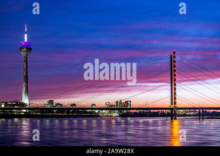 Rhine tower, Rheinknie Bridge over Rhine River and illuminated skyline of Media Harbour in Düsseldorf, Germany - Stock Photo