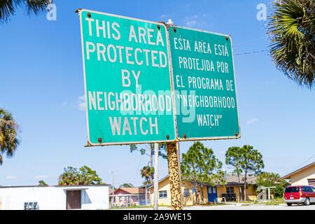 Florida, FL, South, Collier County, Immokalee, Farm Worker Village, neighborhood watch, sign, logo, Spanish language, bilingual, sightseeing visitors - Stock Photo
