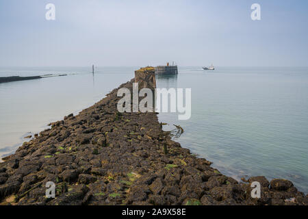 A ship passing the South Pier in Heysham Harbour, Lancashire, England, UK - Stock Photo