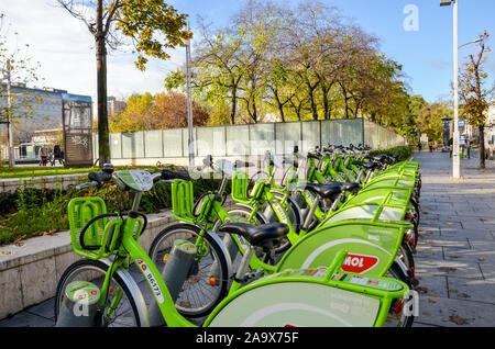 Budapest, Hungary - Nov 6, 2019: Public green bikes for rental in the center of the Hungarian capital city. Bike-sharing. Eco-friendly means of transport. Ecological measures in the cities. Bicycles. - Stock Photo