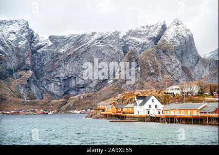 Beautiful Lofoten Islands archipelago winter scenery with traditional yellow fisherman Rorbuer cabins