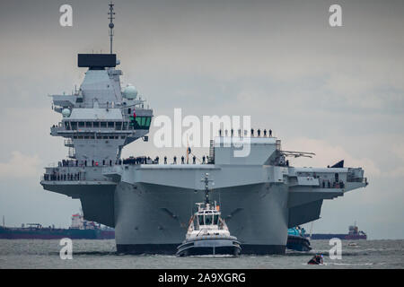 HMS Prince of Wales, the Royal Navy's second Queen Elizabeth-class aircraft carrier, sails into Portsmouth Naval Base for the first time this afternoon, 16th November 2019. The £3.1 billion warship has been undergoing eight weeks of sea trials in the Moray Firth. - Stock Photo