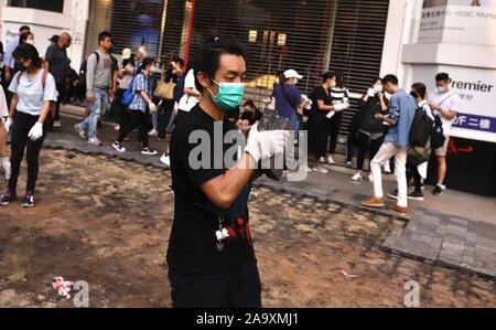 Hong Kong. 18th Nov, 2019. A protester transport a broken stone slabs that is acquired from the pavement using as obstacles to block the road.Nov-18, 2019 Hong Kong.ZUMA/Liau Chung-ren Credit: Liau Chung-ren/ZUMA Wire/Alamy Live News - Stock Photo