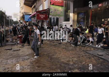 Hong Kong. 18th Nov, 2019. Large portion of stone slabs are being dug out from the pavement by protesters for use of obstacles to block the main avenue on Nathan Road.Nov-18, 2019 Hong Kong.ZUMA/Liau Chung-ren Credit: Liau Chung-ren/ZUMA Wire/Alamy Live News - Stock Photo