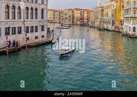 Venice, Italy Polizia Locale di Venezia Patrol Boat with Italian flag sailing at the Venetian lagoon Grand Canal, at Rialto Bridge area. - Stock Photo