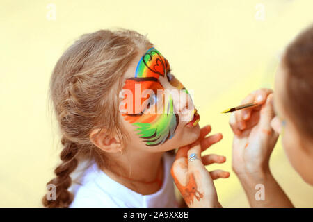 children's makeup artist, does animation make-up on little girls - Stock Photo