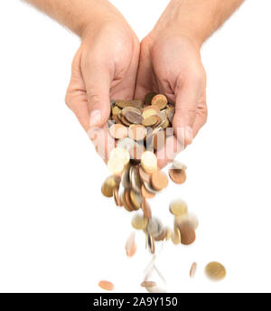 Coins of different countries falling from palm hands, isolated on white background - Stock Photo