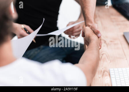 close up. welcome handshake business people in the office - Stock Photo