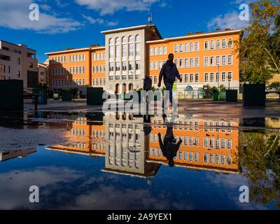 Elementary school Nikola Tesla in Rijeka in Croatia people walking by across frame - Stock Photo