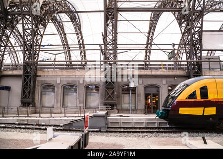 High-speed train on platform of railway station - Stock Photo