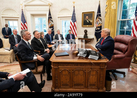 President Donald J. Trump participates in a working visit with Secretary General of the North Atlantic Treaty Organization (NATO) Jens Stoltenberg Thursday, Nov. 14, 2019, in the Oval Office of the White House. - Stock Photo