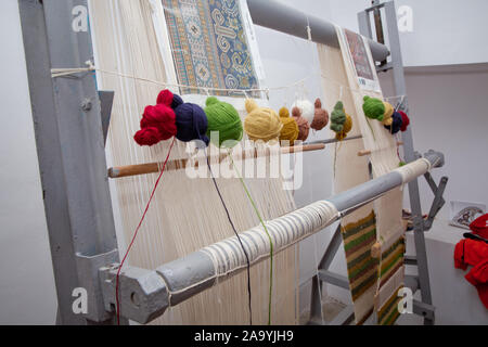 Various yarn on weaving handmade carpet . manual production of carpets . Dyed Threads to be Used For Weaving Azerbaijan Carpets . - Stock Photo