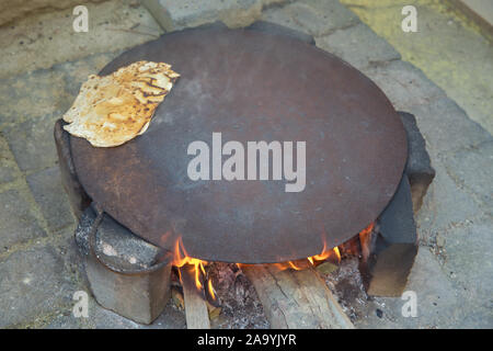 outdoor oven Traditional way of baking bread , Tava, Tabun oven Arabic Campfire outdoor stove used chiefly for baking bread and pitta, - Stock Photo