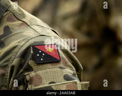 Flag of Papua New Guinea on military uniform. Army, armed forces, soldiers. Collage. - Stock Photo