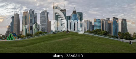 Doha, Qatar-November 18,2019: Doha, Qatar  Skyline daylight view from Sheraton park  with clouds in sky in background - Stock Photo