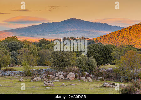 landscape last rays of afternoon sun over the mountains of the Sierra de Guadarrama. madrid Spain. - Stock Photo