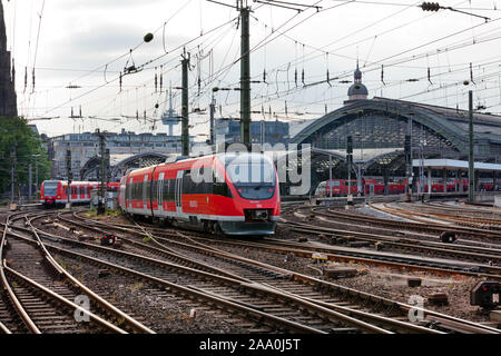 An Intercity Express train of Deutsche Bahn departures from the Cologne train Station in Germany - Stock Photo