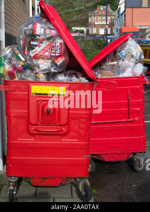 Aberystwyth Ceredigion/UK November 13 2019: Overflowing large recycling bins waiting for collection outside student halls of residence - Stock Photo