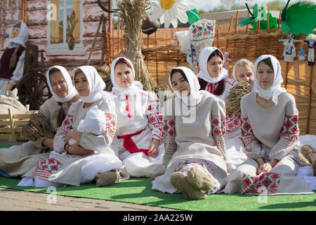 Belarus, the city of Gomil, September 14, 2019. City holiday. A group of Slavic women in national clothes. Young Ukrainian or Belarusian girls in embr - Stock Photo